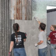 The AU team cleaning and priming the walls.
