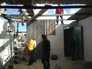Avenue Church's mens team removing the old tin roof.