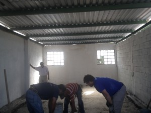 Avenue Church's men's team finished the roof; now moving on to level and pour new concrete flooring.