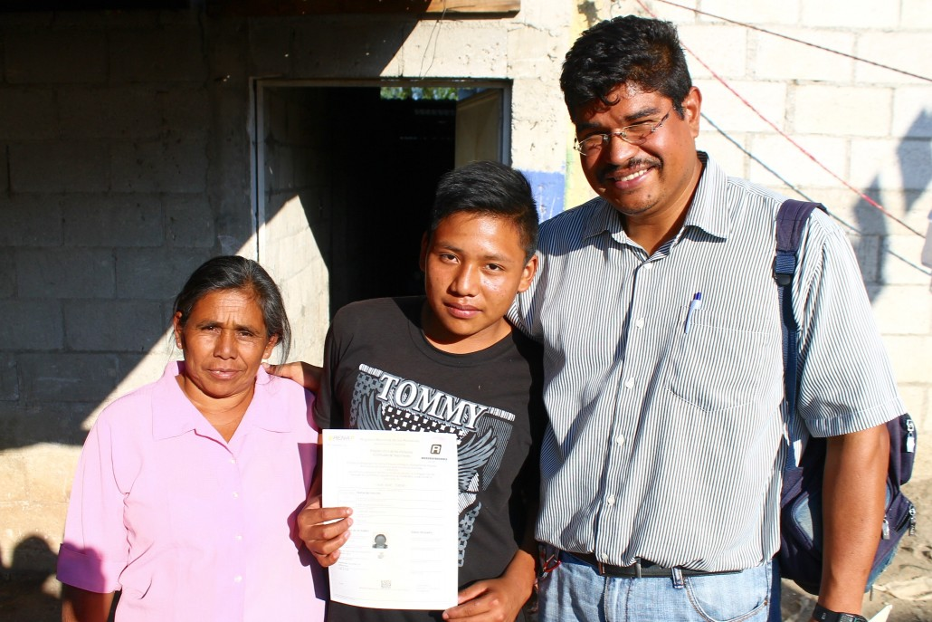 Juanes' mother, Gregoria Cutzal, Juanes, and Engadi's Director of Discipleship, David Medina outside Juanes home.