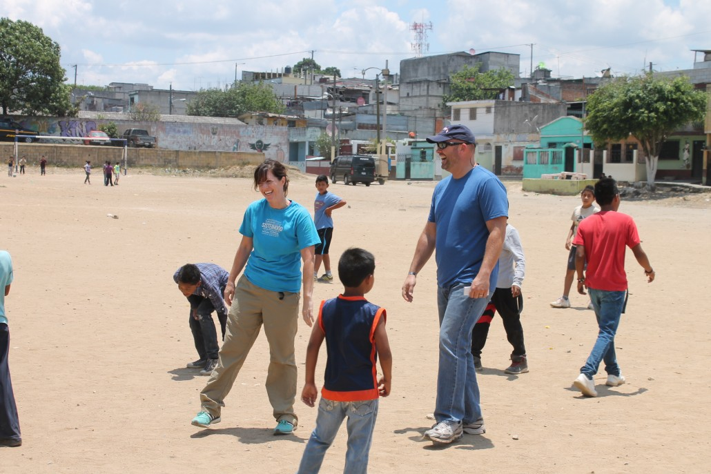 Sharie and Clayton King playing with children in Paraíso Guatemala